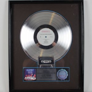 Offered here is one of the Platinum Records awarded from the R.I.A.A. for sales of more than 1000,000 copies. Presented To Steve Russo. The California Raisins were a fictional rhythm and blues musical group as well as advertising and merchandising characters composed of anthropomorphized raisins. Lead vocals were sung by musician Buddy Miles. The California Raisins concept experienced high popularity in the mid-to-late 1980s principally through claymation TV commercials and animated specials, winning an Emmy Award and one nomination COA From Steve Russo.